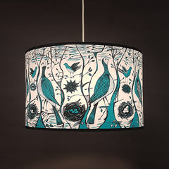 wide lampshade with print of birds in turquoise and black
