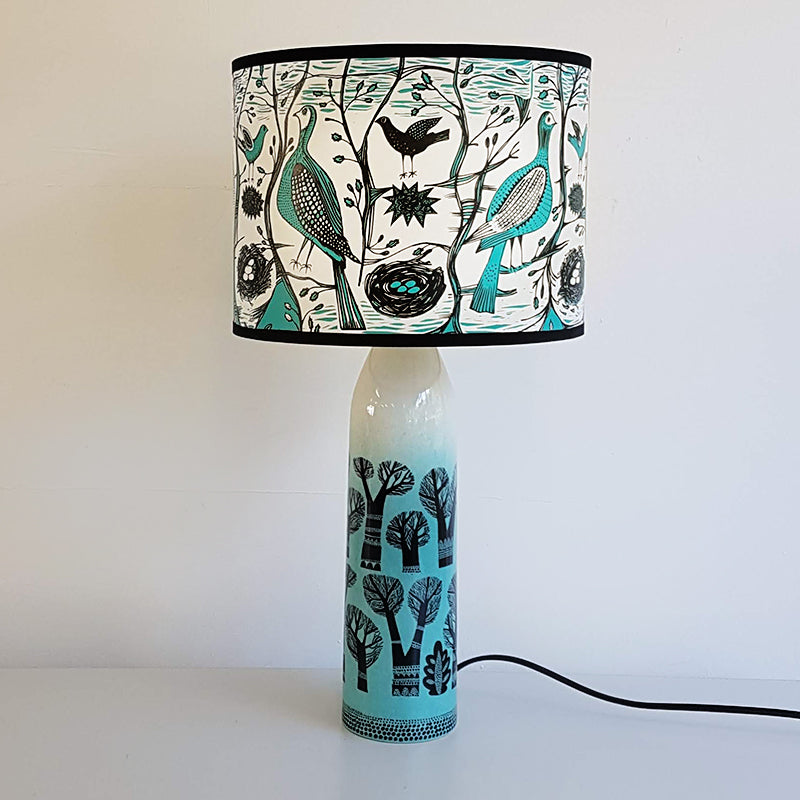 Lush Designs winter tree print lamp in teal, black and white featuring bird print on shade