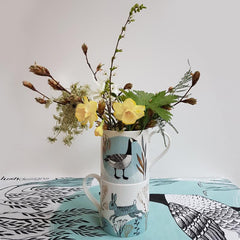 Lush designs mugs with goose and rabbit print containing yellow flowers
