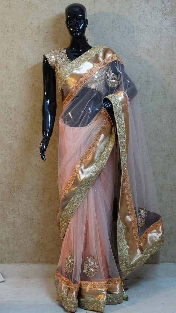 Pastel on Pastel Peach Net Saree with heavy Border and Motifs