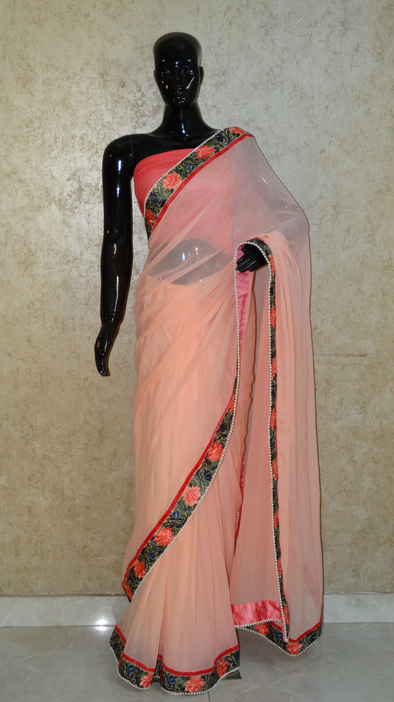 Pure Georgettte Peach Saree with Floral Parsi Border