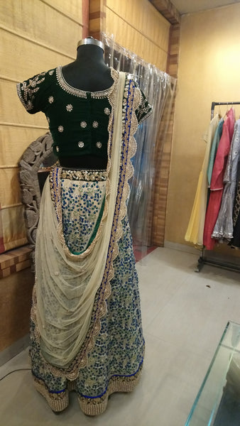 Butterscotch Creme Lehenga with Bottle Green Blouse