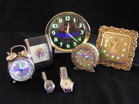 Antique watches may still glow in the dark due to radium paint, so it's wise to test for radioactivity before purchasing watches made before the 1950s.