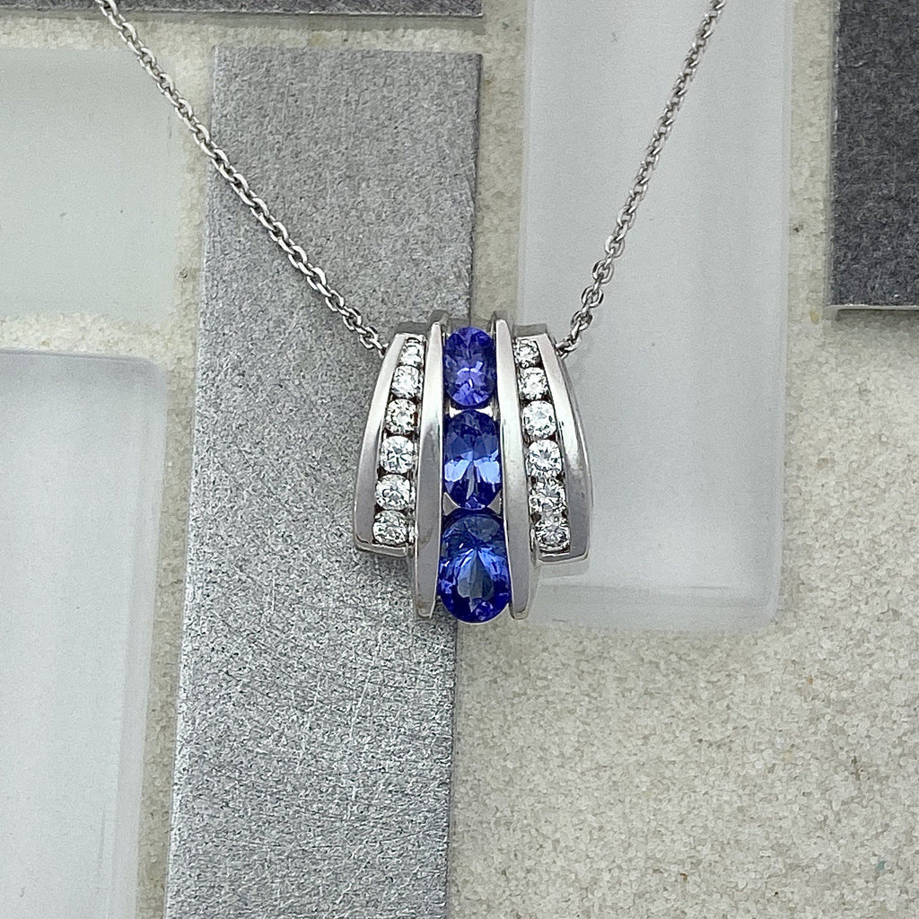 14k White Gold Channel Set Tanzanite and Diamonds .34cttw Necklace - DePaulas