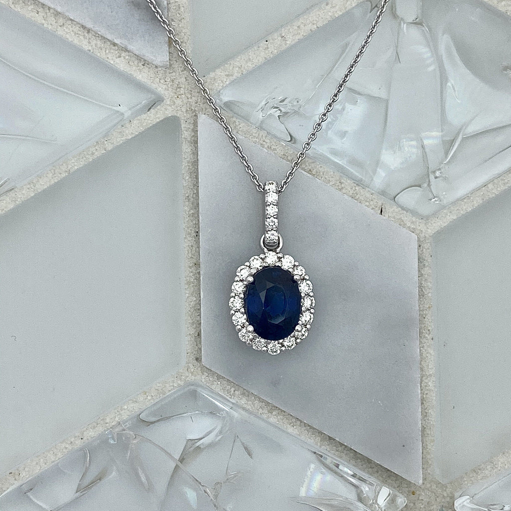 14k White Gold Oval Sapphire 1.60ct with Diamond Halo .38cttw Necklace - DePaulas