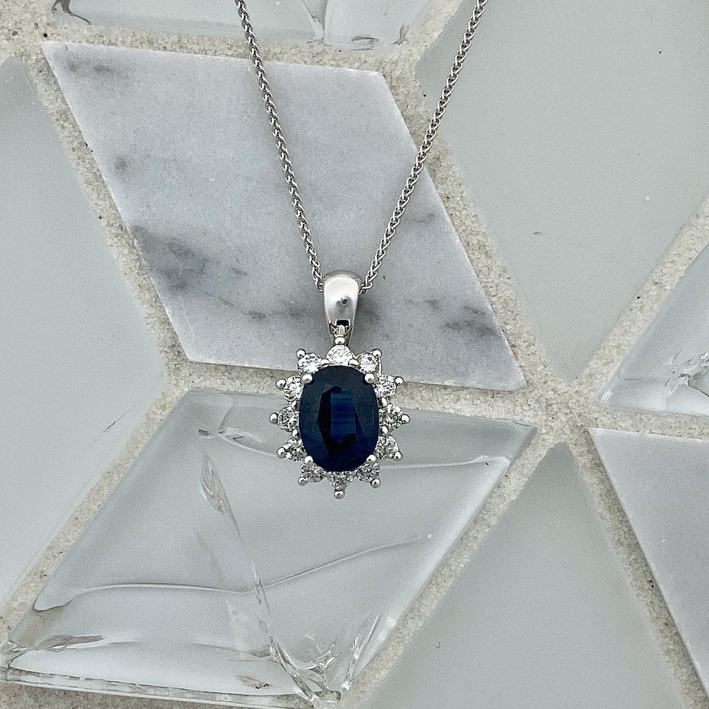 14k White Gold Oval Sapphire 1.28ct with Diamond Halo .34cttw Necklace - DePaulas