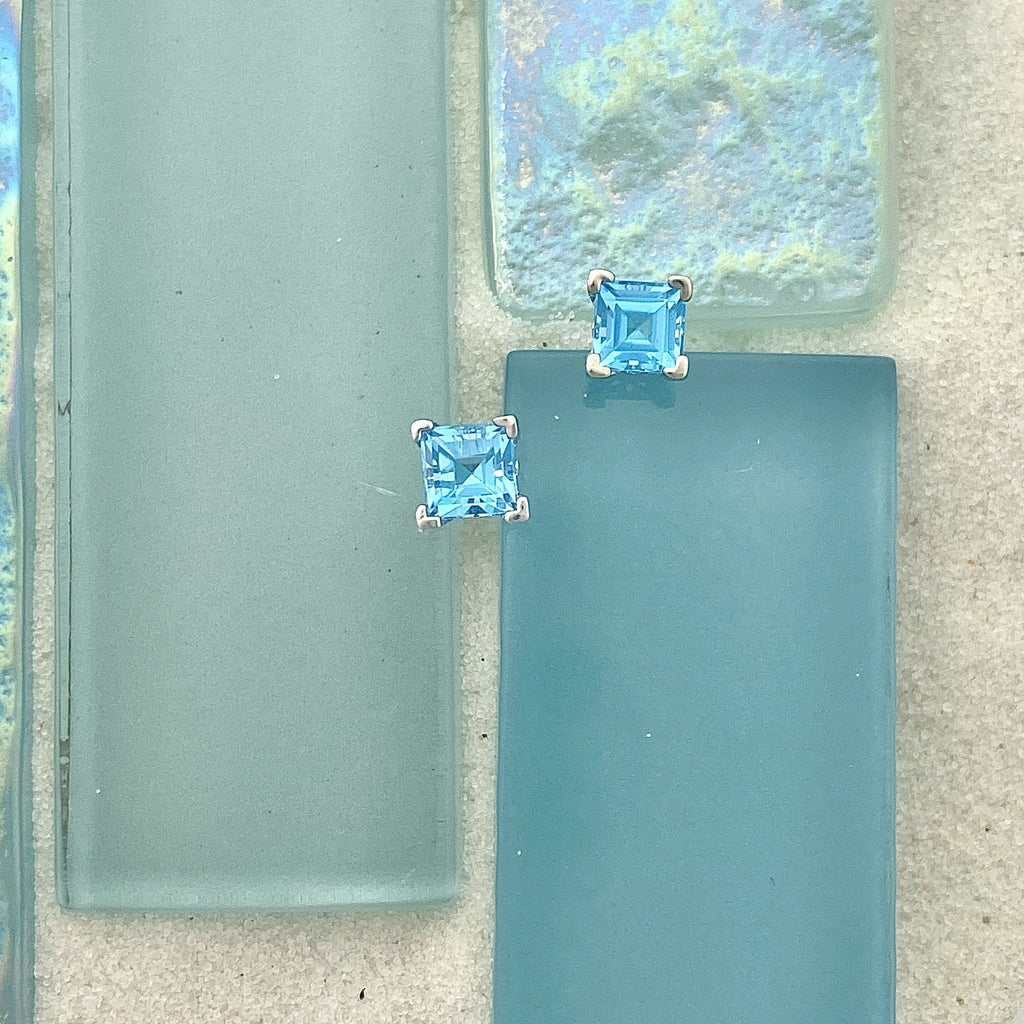 14k White Gold Princess Cut Blue Topaz Post Earrings - DePaulas