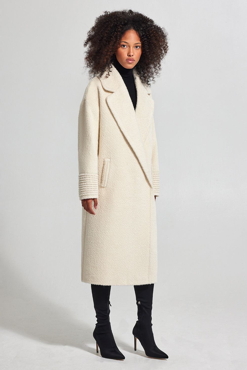 Sentaler Bouclé Alpaca Long Oversized Notched Collar Coat featured in Bouclé Alpaca and available in Ivory. Seen from side.