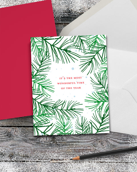 Festive Christmas Card with Green Pine Boughs by Smirkantile.
