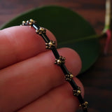 Temple Tree Curio Weave Beaded Bugle Bracelet - Black and Bronze