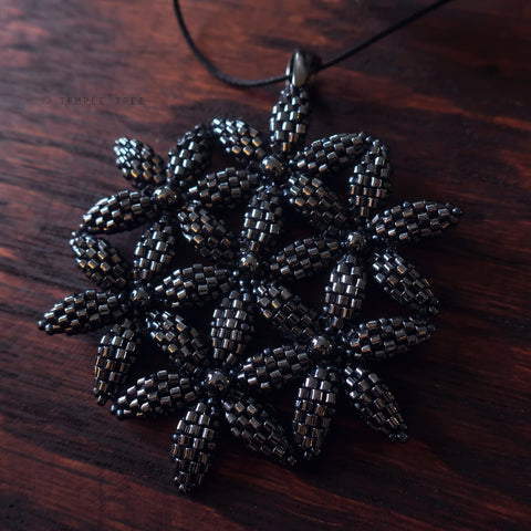 Temple Tree Flower of Life Beaded Pendant - Hematite