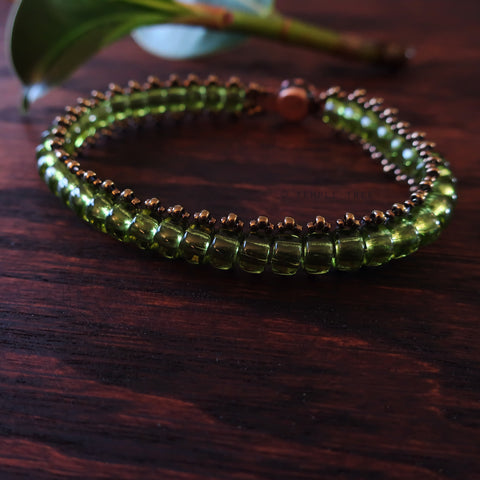 Temple Tree Boho Glass Bead Caterpillar Weave Bracelet - Peridot Green and Bronze