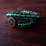 Temple Tree Boho Glass Bead Caterpillar Weave Bracelet -Sparkly Emerald and Bronze