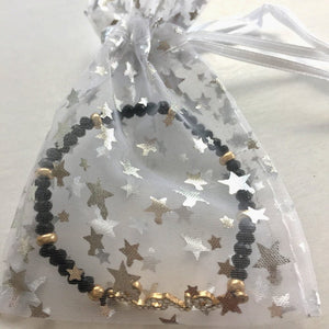 black gold white jewelry bag