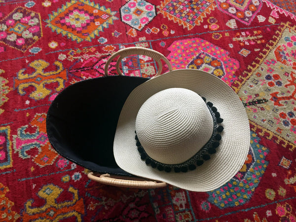 black straw hat and bag