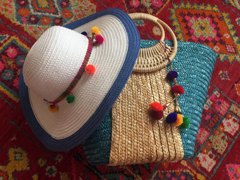 blue beach bag and white hat