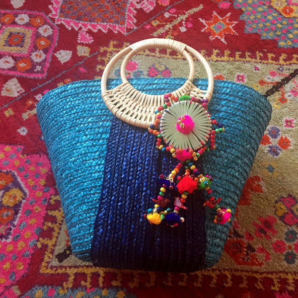 blue straw bag with colorful tassel