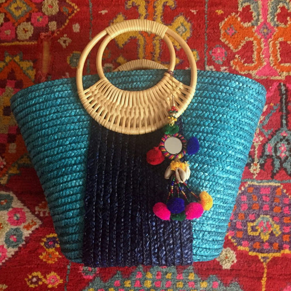 blue colorful pom pom bag