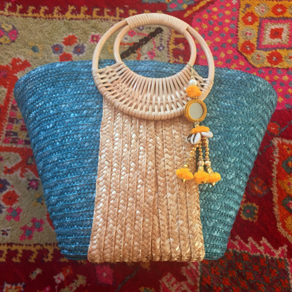 turquoise and natural straw bag with yellow tassel