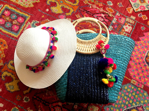 white hat blue beach bag