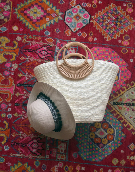 white bag with beige hat