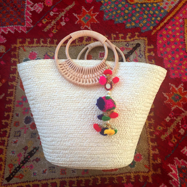 white colorful pom pom beach bag