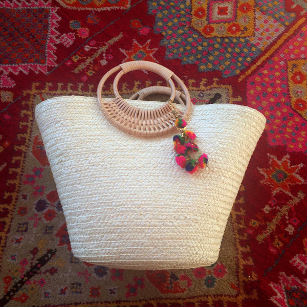 white beach bag with colorful tassel