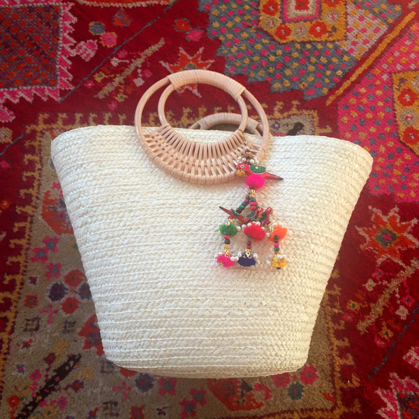 white beach bag with parrot tropical tassel