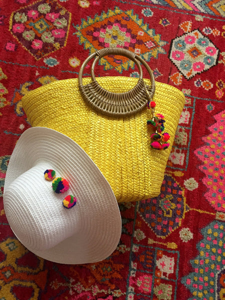 pom pom yellow beach bag and white hat