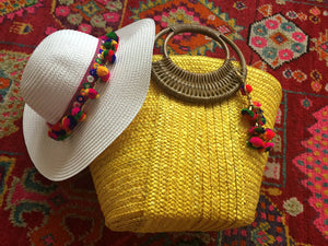 yellow beach bag white colorful hat