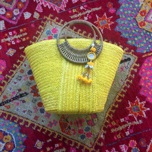 yellow beach bag with yellow tassel