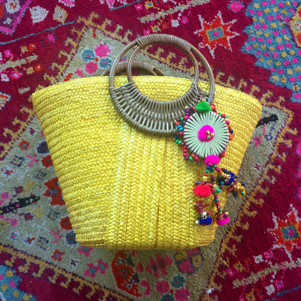 yellow beach bag with large colorful tassel