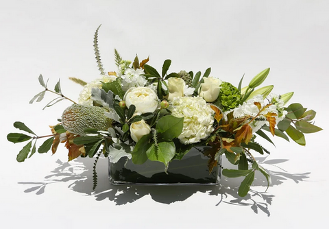long and low white thanksgiving floral arrangement