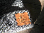 Close-up of leather patch on gray PT's Coffee beanie