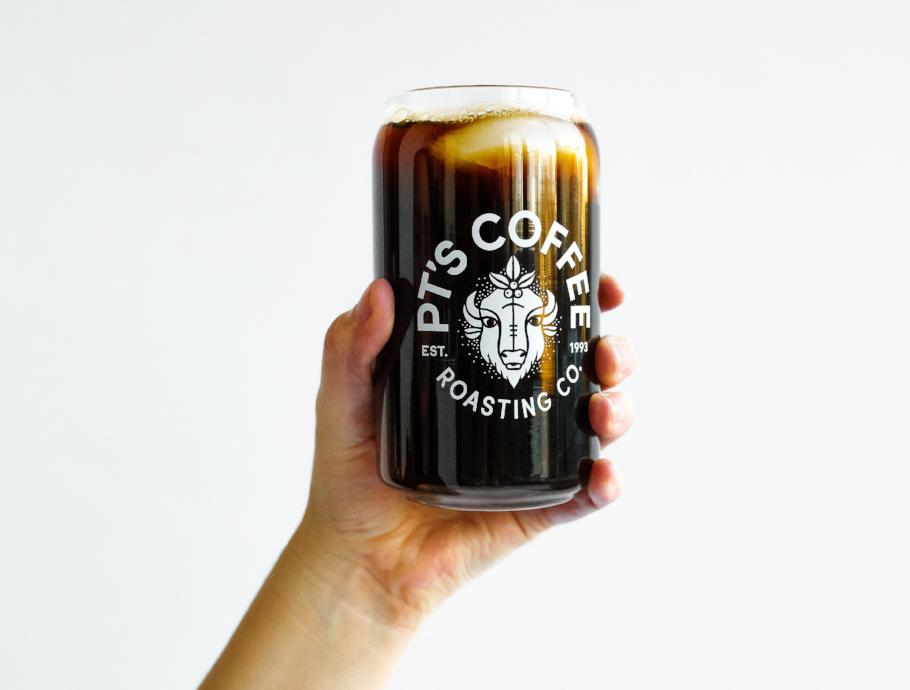 Hand holding a PT's Coffee Bison Logo Can Glass