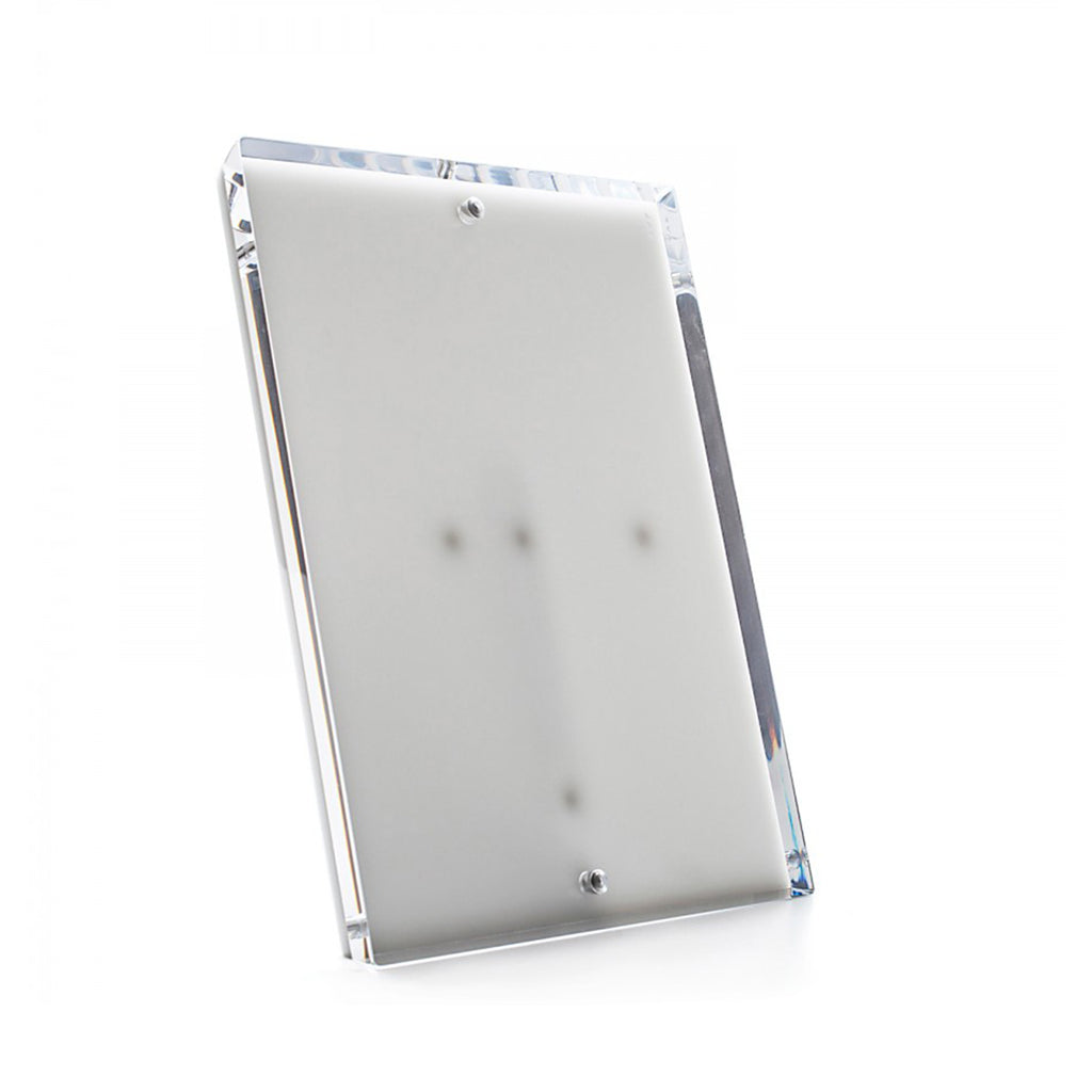 Alexandra Von Furstenberg clear acrylic snap picture frames. Can be configured to display a portrait or landscape photo.
