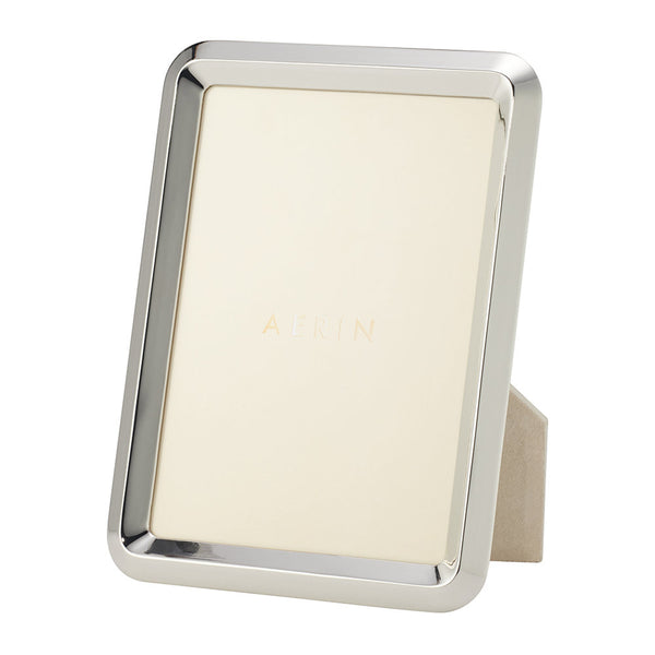 Use the AERIN Silver Frame to showcase your favourite photographs with this Archer photo frame from AERIN. Plated in zinc, this photo frame has clean lines and a highly polished finish   Material: zinc, suede