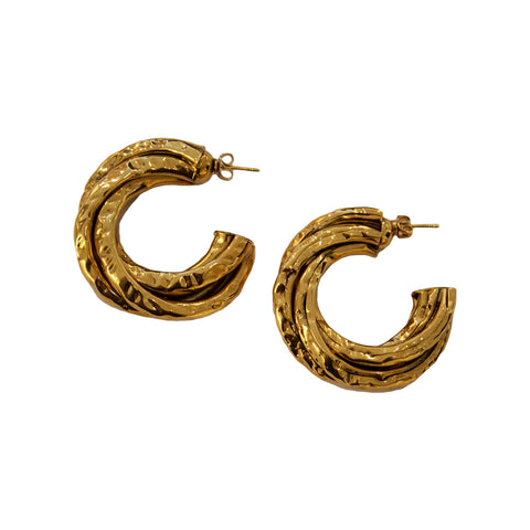 Pair of French Poggi Paris gold metal pieced hoop earrings.