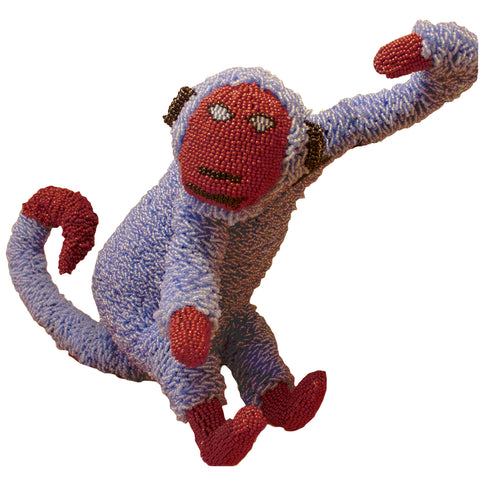Beaded blue monkey handcrafted by female artisans in Africa. These joyful sculptures add whimsy and colour to any room.