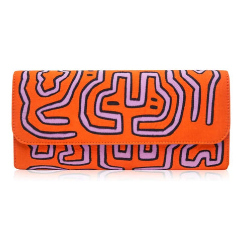 Mola Sasa clutch in orange and pink. Handcrafted by artisans in Columbia with cotton and natural yute.