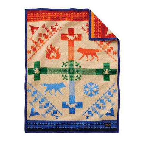 Pendleton blankets are heirloom-quality wool blankets made in the USA using wool that sourced from ranches around the country. This blanket tells the story of how the trickster coyote stole Fire  from the tall mountain and gave it to the People.