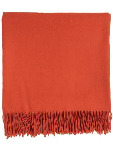 Baby alpaca throw in warm, earthy orange.