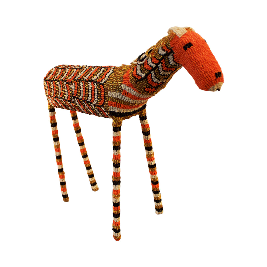 Beaded horse handcrafted by female artisans in Africa. These joyful sculptures add whimsy and colour to any room.