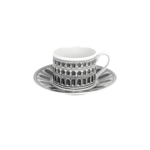 The Fornasetti architettura teacup and saucer are created of fine bone china and add a graphic punch to tea time