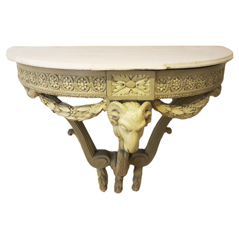 1920s French carved wall-mounted console table with ram's head detailing.