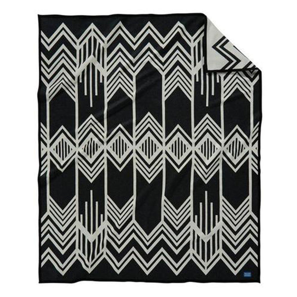 Pendleton blankets are heirloom-quality wool blankets made in the USA using wool that sourced from ranches around the country. This reversible skywalkers design was inspired by the Art Deco design elements that distinguish New York City's most iconic buildings, and it was intended to honour the skilled Indigenous steel workers who built some of the city's landmarks.