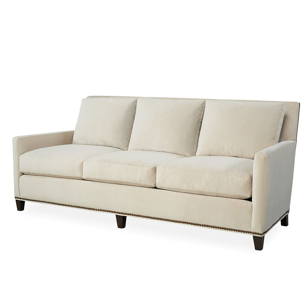 Contemporary sofa with wooden legs and nail head detailing
