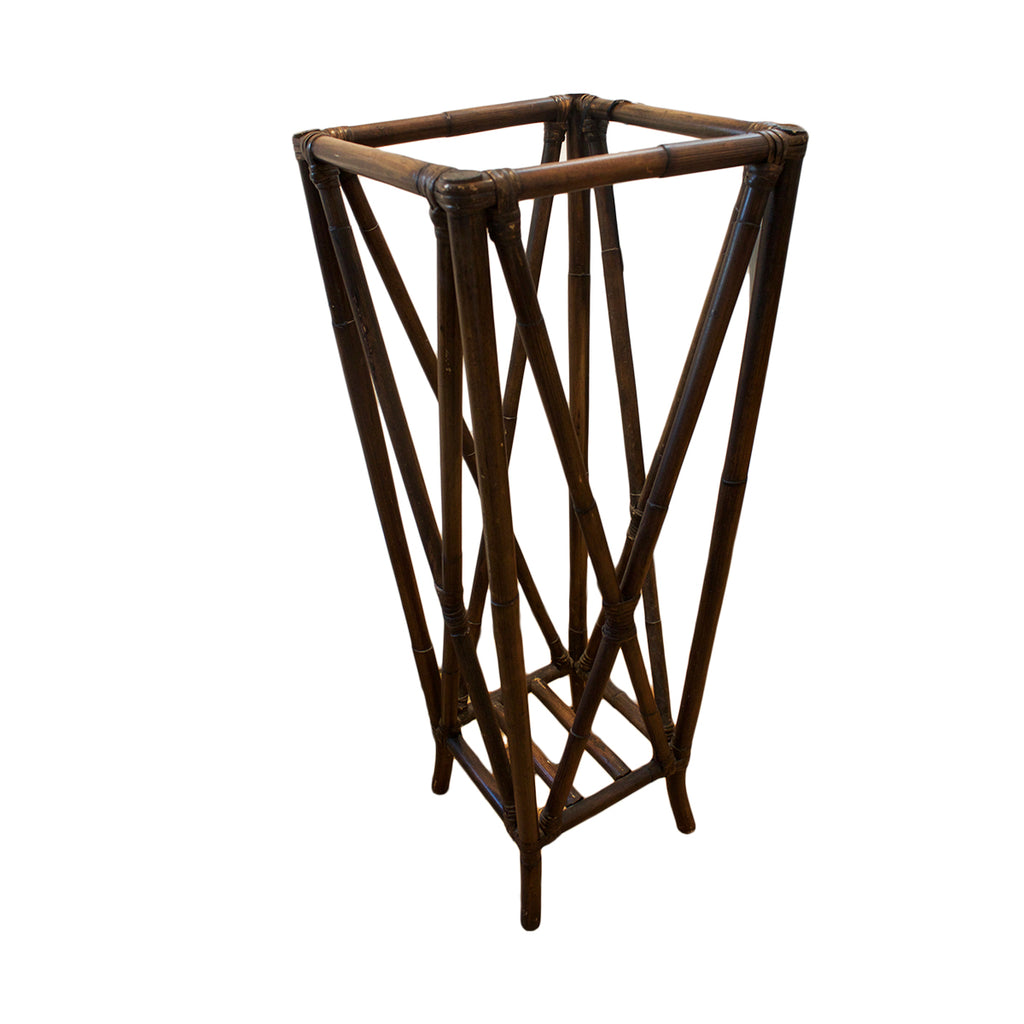 Vintage bamboo umbrella stand for the traditional entranceway.