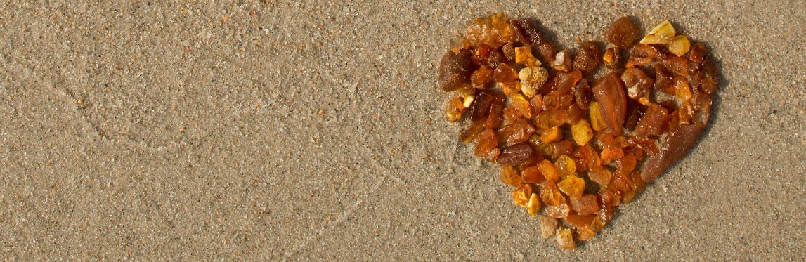 Baltic Amber heart on beach