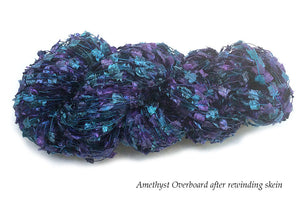 Hand-painted novelty flag-style yarn in Amethyst Overboard (deep purples/blues/teals)